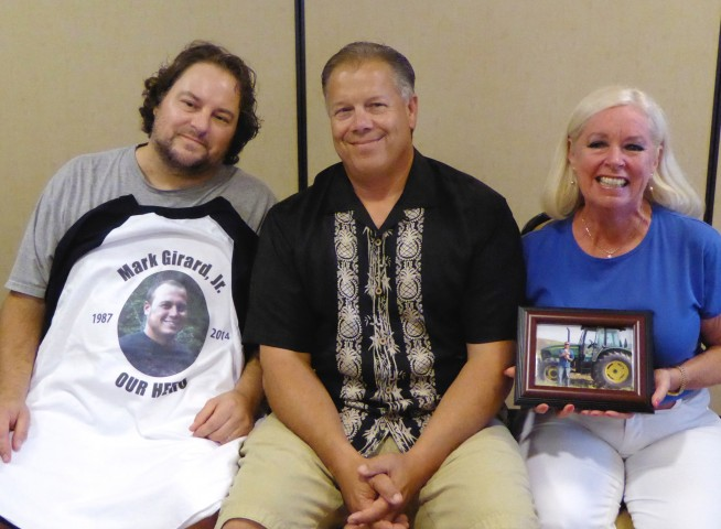 From left:  Heart recipient Jon Marsh with a special shirt honoring his donor Mark Girard, Jr;  Mark Girard, Sr.; and Carol Knott, Recipient & Donor wife